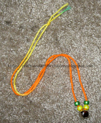 DIY Jingle Bell Necklace - craft idea to go along with The Polar Express