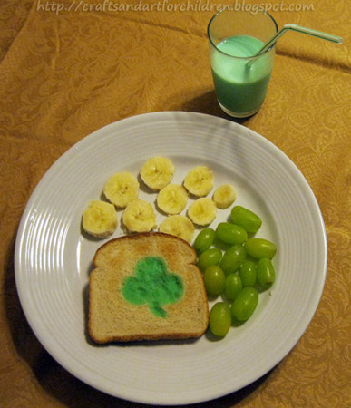 Super Simple St. Patrick's Day Snack Idea for Kids: Banana Gold Coins, Green Milk, Painted Milk Shamrock Toast & Green Grapes