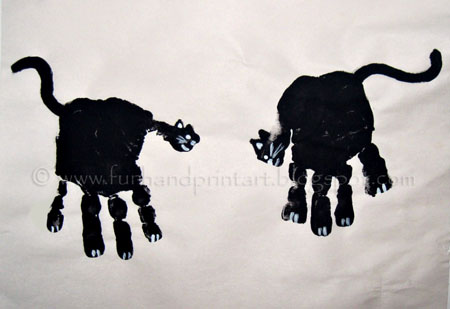 Handprint Black Cat