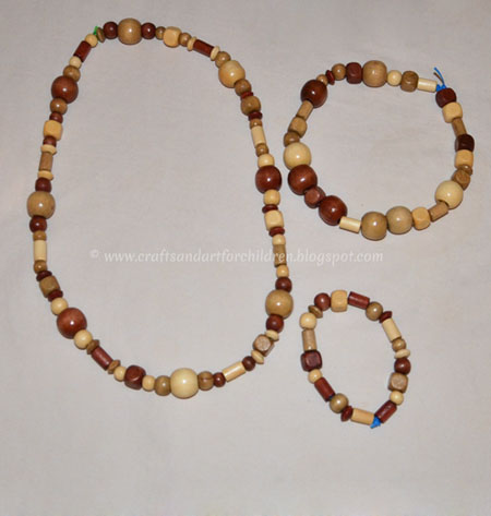 Necklace craft for kids using wood beads artsy momma for Necklace crafts for kids