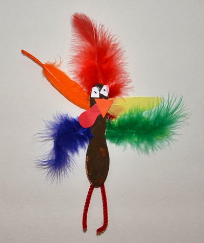 Craft Stick Turkey - Kids Thanksgiving Craft- a silly looking turkey with red, orange, yellow, blue, and green feathers