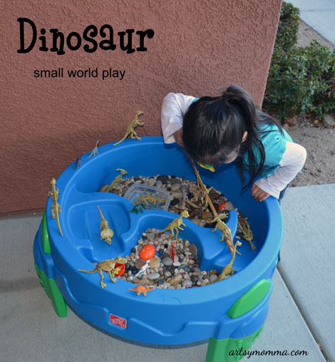 Exploring a Dinosaur Small World play and sensory bin