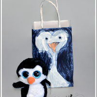 Kid-made Gift Wrap Idea: Make a Penguin Gift Bag!