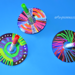 How to make colorful spinning tops from recycled CDs