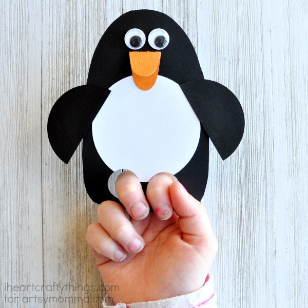 Today we are sharing how to make this cute DIY penguin puppet. It is super simple to make and is perfect for an afternoon full of pretend play.