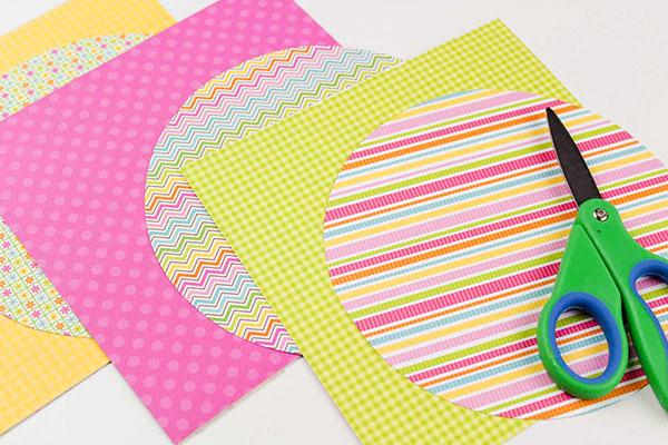 Butterfly Craft Instructions: Trace circle shapes onto patterned cardstock to create wings