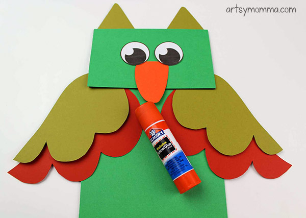Glue pieces to paper bag owl