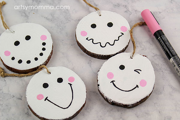 Add rosy pink snowman cheeks with pink paint