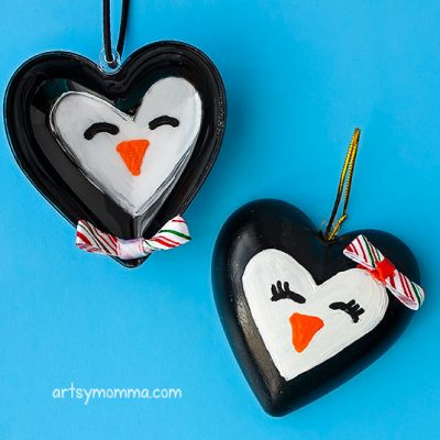 Turn Clear Plastic Heart Ornaments Into Adorable Penguins To Hang On The Christmas Tree