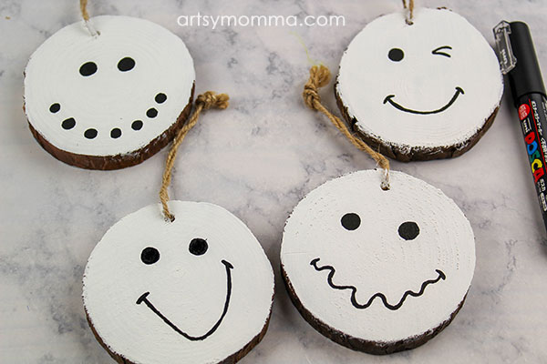 Add expressions to the snowman ornaments with a black paint pen