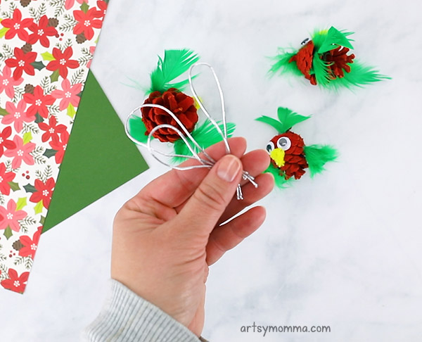Add ornament string to the pinecone