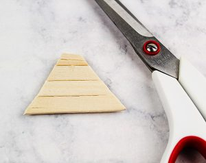 cut mini craft sticks to form triangle