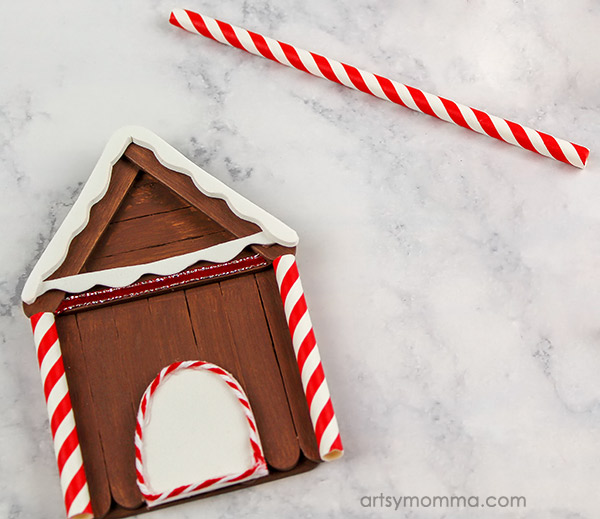 How to make a mini gingerbread house from craft sticks - glue on straws
