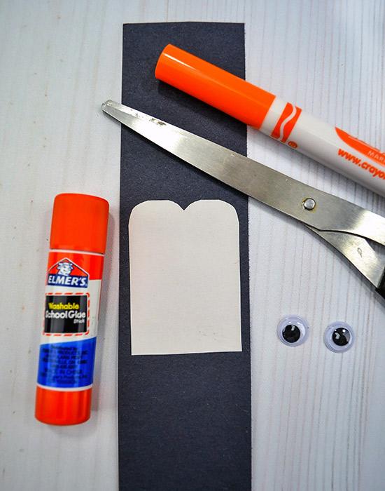 Construction Paper Penguin Craft - glue white body on black strip