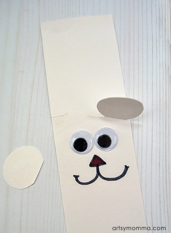 Construction Paper Polar Bear Craft - add ears through slits