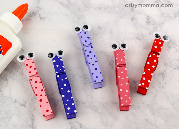 glue two googly eyes on the top of each clothespin