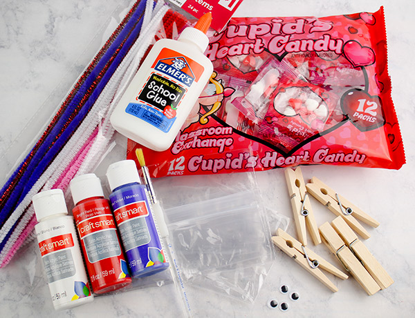DIY Valentine's Candy Bag Craft Supplies: paint, candy hearts, clothespin, snack size baggies, googly eyes