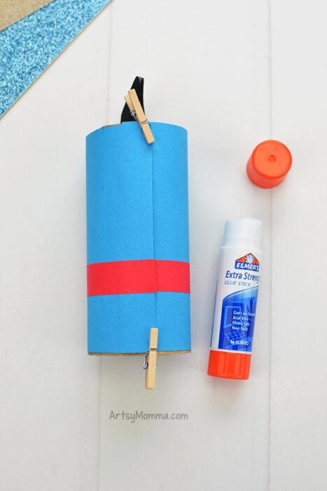 Glue paper template around cardboard