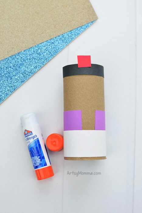 Glue Aladdin's Clothes to the cardboard tube