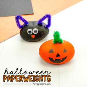 Halloween Themed Painted Rocks (black cat & pumpkin) that can be used as paperweights
