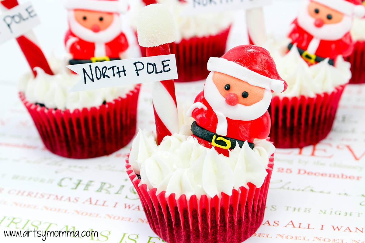 north pole santa christmas cupcakes on table