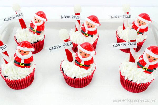 santa cupcakes arranged on tray