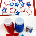 Star art project and supplies needed: paint, glitter, star shaped cookie cutters