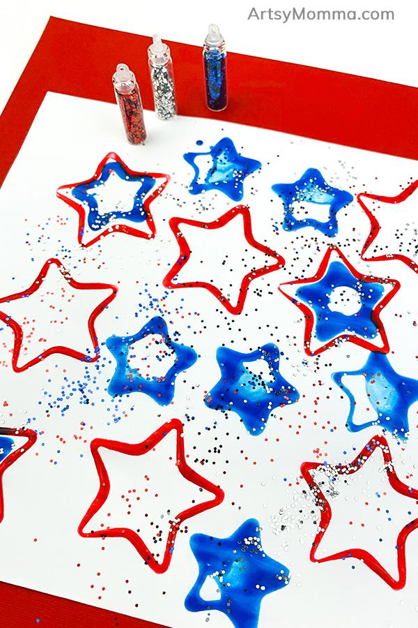 glitter sprinkled over painted stars