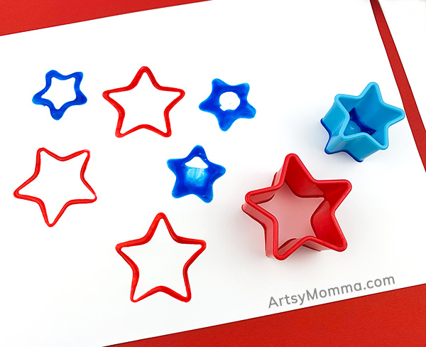 red and blue stars painted with cookie cutters